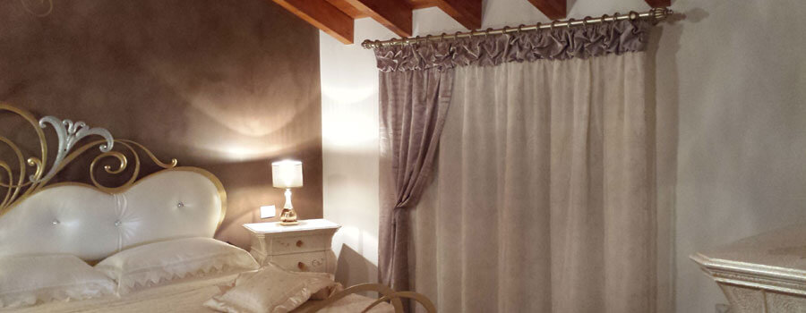 Emejing Tende Classiche Per Camera Da Letto Photos - Design Trends ...